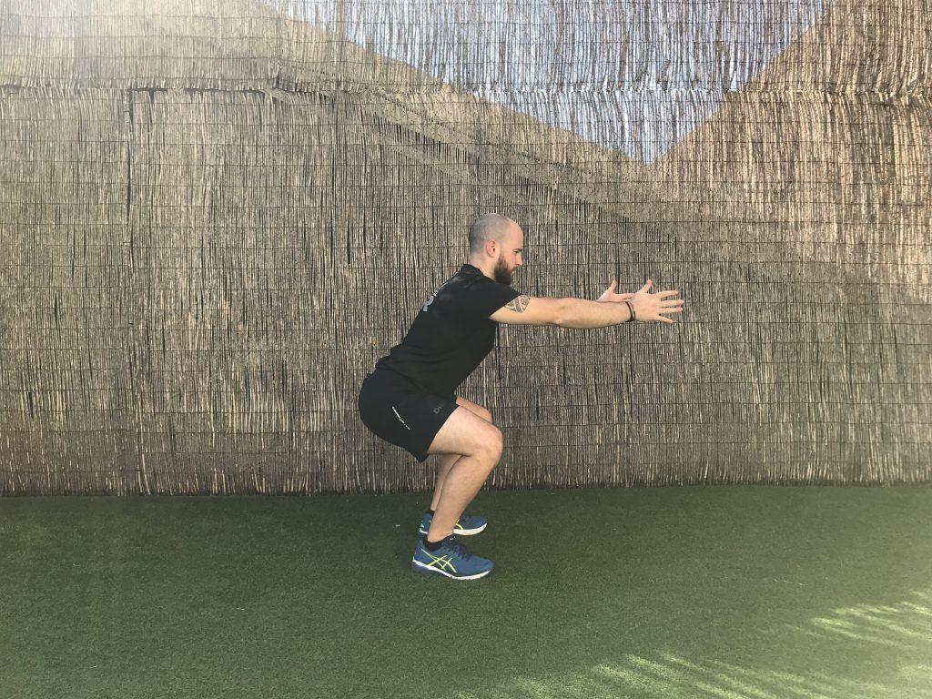 ejercicios de piernas squat jump