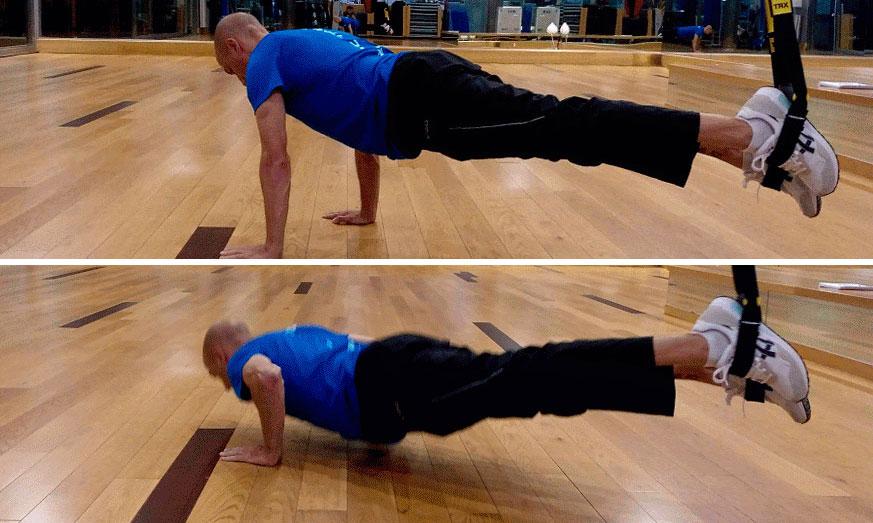 ejercicio TRX de flexión push up prono